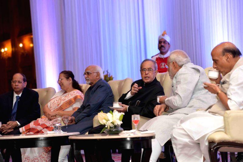 President Pranab Mukherjee, Vice-President Mohammad Hamid Ansari, Lok Sabha Speaker Sumitra Mahajan, Prime Minister Narendra Modi and Union Home Minister Rajnath Singh during a programme ... - Sumitra Mahajan, Narendra Modi, Pranab Mukherjee and Rajnath Singh