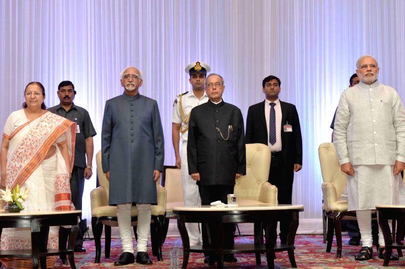President Pranab Mukherjee, Vice-President Mohammad Hamid Ansari, Lok Sabha Speaker Sumitra Mahajan  and Prime Minister Narendra Modi during a programme organised on Civil Services Day in ... - Sumitra Mahajan, Narendra Modi and Pranab Mukherjee