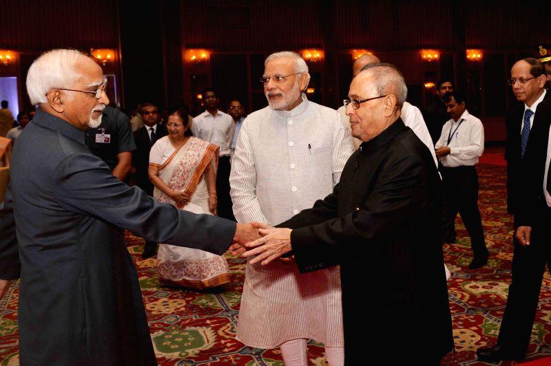 President Pranab Mukherjee, Vice-President Mohammad Hamid Ansari and Prime Minister Narendra Modi during a programme organised on Civil Services Day in New Delhi, on April 21, 2015. - Narendra Modi and Pranab Mukherjee