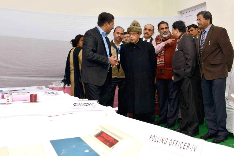 President Pranab Mukherjee visits the model polling booth, at Dr. Rajendra Prasad Sarvodaya Vidyalaya, President`s Estate, in New Delhi, on Feb. 7, 2015.