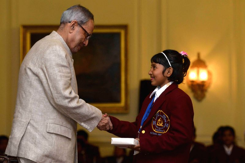 President Pranab Mukherjee with National Bravery Awards-2014 winner at Rashtrapati Bhavan, in New Delhi on Jan 22, 2015. - Pranab Mukherjee