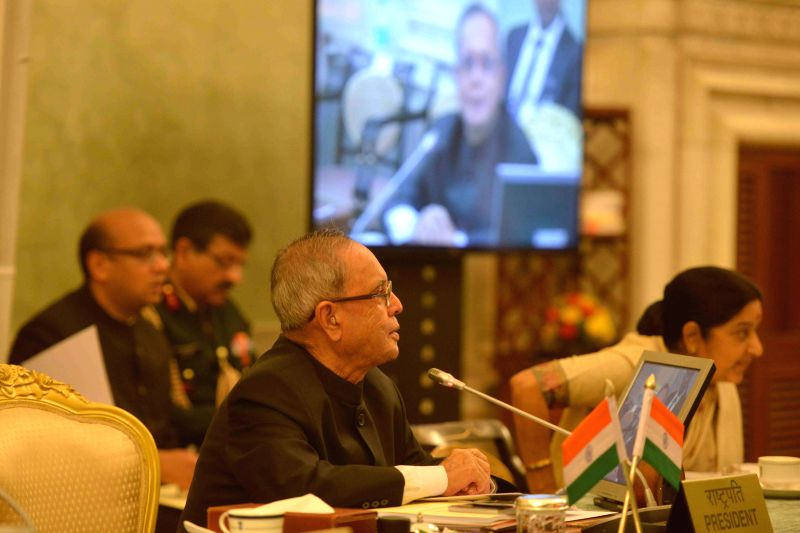 President Pranab Mukherjee with External Affairs Minister Sushma Swaraj at the Conference of Governors at Rashtrapati Bhavan, in New Delhi on February 12, 2015. - Sushma Swaraj and Pranab Mukherjee
