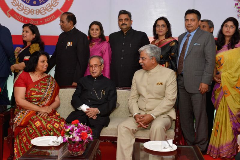 President Pranab Mukherjee with Delhi Police chief B S Bassi during the `At Home` function organised on the raising day of Delhi Police in New Delhi, on Feb 17, 2015. - Pranab Mukherjee