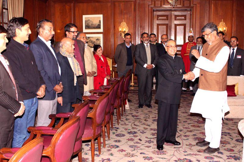 President Pranab Mukherjee with Nobel laureate Kailash Satyarthi  during a programme at Rashtrapati Bhavan in New Delhi, on Jan 7, 2015. - Pranab Mukherjee
