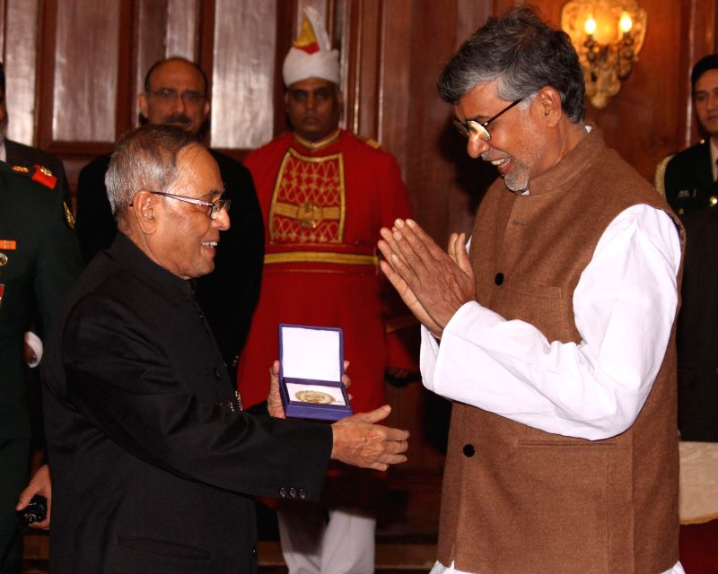 President Pranab Mukherjee with Nobel laureate Kailash Satyarthi  during a programme at Rashtrapati Bhavan in New Delhi, on Jan 7, 2015. - Pranab Mukherjee