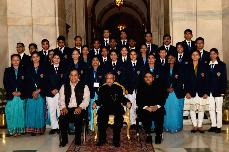 President Pranab Mukherjee with the recipients of the Indira Gandhi National Service Scheme Awards 2013-14, at Rashtrapati Bhavan, in New Delhi on Nov 19, 2014. Also seen Union Minister of - Pranab Mukherjee