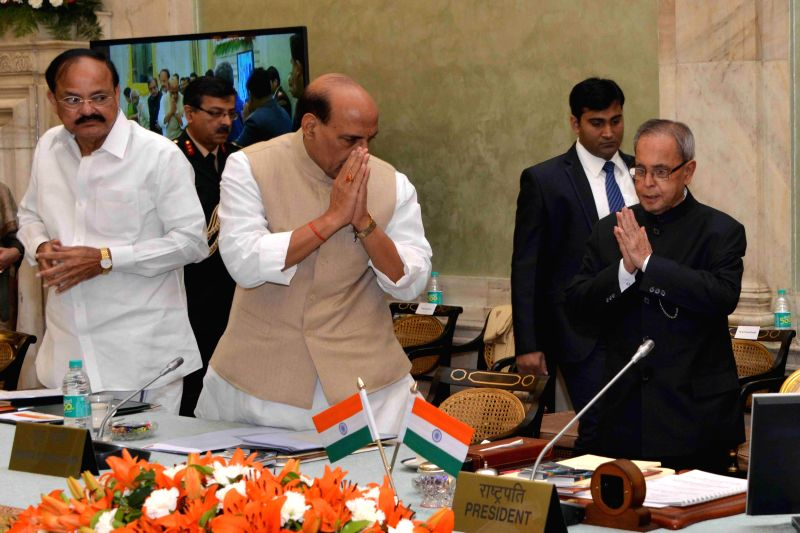 President Pranab Mukherjee with the Union Home Minister Rajnath Singh  and the Union Minister for Urban Development, Housing and Urban Poverty Alleviation and Parliamentary Affairs, M. ... - Rajnath Singh, M. Venkaiah Naidu and Pranab Mukherjee