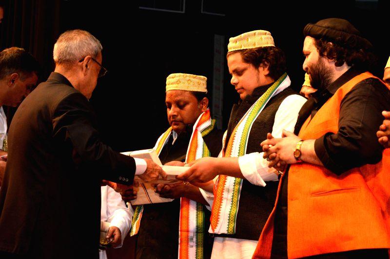 President Pranab Mukherjee with the artist of the Sufiana Qawali, at Rashtrapati Bhavan, in New Delhi on March 12, 2015. - Pranab Mukherjee