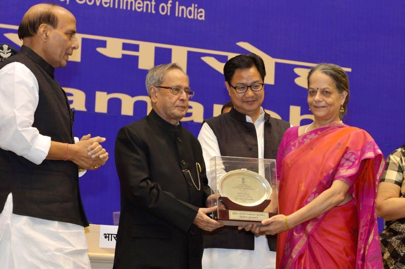 President Pranab Mukherjee with Union Home Minister Rajnath Singh and Union Minister of State for Home Affairs, Kiren Rijiju during presentation of Rajbhasha Award in New Delhi on Nov. 15, - Rajnath Singh