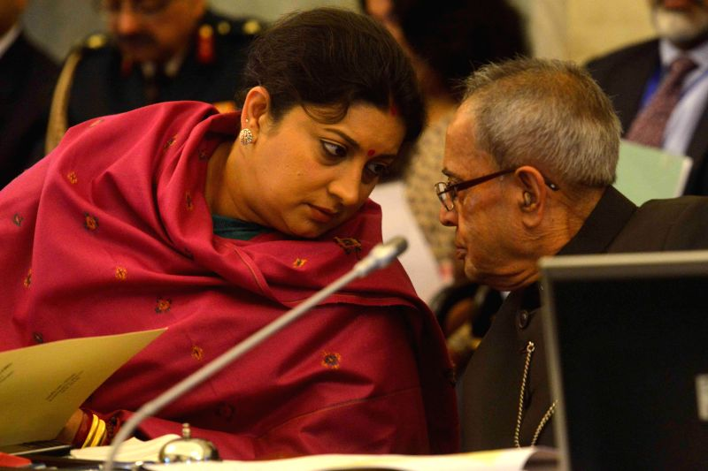 President Pranab Mukherjee with Union Minister for Human Resource Development, Smriti Irani during the conference of `Vice Chancellors of Central Universities` at Rashtrapati Bhavan in New - Pranab Mukherjee and Smriti Irani