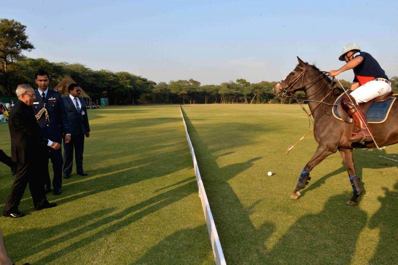 President Pranab Mukherjee witness the President`s Polo Cup Exhibition match at PBG Parade Ground in New Delhi on Dec. 6, 2014. - Pranab Mukherjee