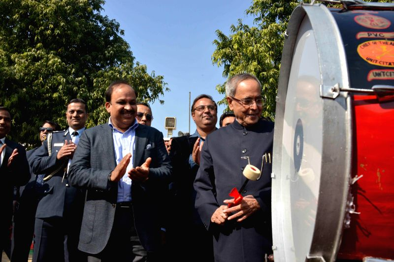 President Pranab Mukjerjee beats a drum during his birthday celebrations in the President's Estate in New Delhi, on Dec 11, 2014.