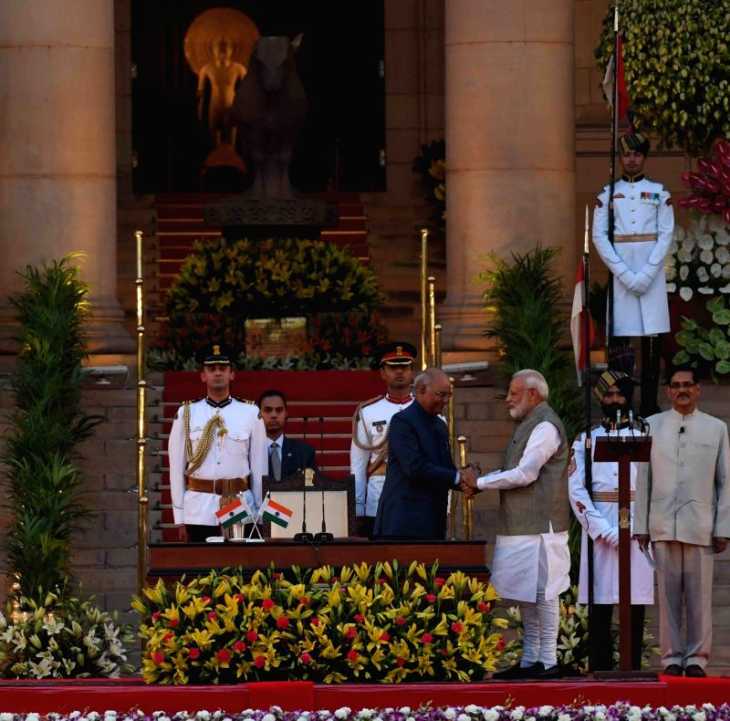 New Delhi: President Ram Nath Kovind administers the oath of office to Narendra Modi as the Prime Minister of India at a swearing-in ceremony at the Rashtrapati Bhavan in New Delhi on May 30, 2019. (Photo: IANS/RB)