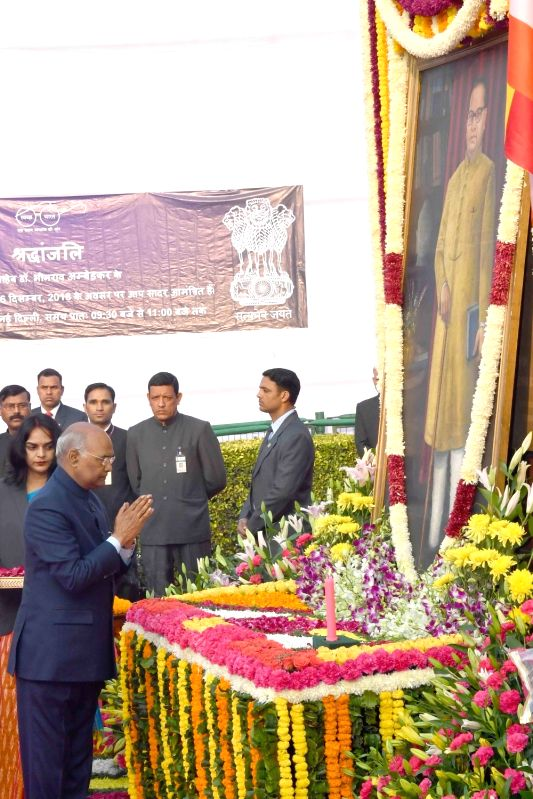 : New Delhi: President Ram Nath Kovind pays tributes to Dalit icon B. R. Ambedkar on his death anniversary at Parliament in New Delhi, on Dec 6, 2018. (Photo: IANS/RB).(Image Source: IANS)
