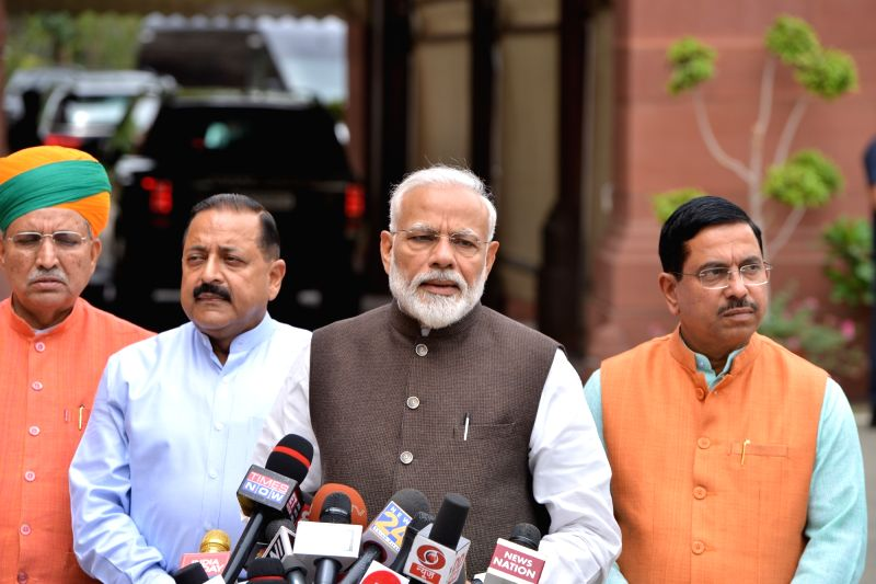 New Delhi: Prime Minister Narendra Modi accompanied by Union Ministers Jitendra Singh and Arjun Ram Meghwal, talks to the media persons on his arrival at Parliament house, in New Delhi on June 17, 2019.