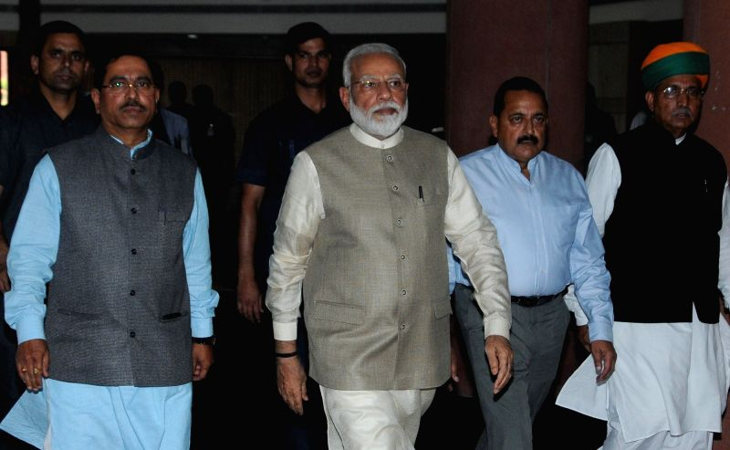 New Delhi: Prime Minister Narendra Modi accompanied by Union Ministers Jitendra Singh and Arjun Ram Meghwal, arrives to chair an all-party meeting to discuss his 'one nation, one election' proposal, in New Delhi on June 19, 2019. The meeting was skip