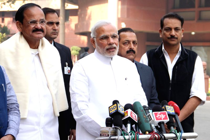 Prime Minister Narendra Modi addresses press ahead of attending the first day of Parliament's winter session in New Delhi, on Nov 24, 2014. Also seen the Union Minister for Parliamentary .. - Narendra Modi, M. Venkaiah Naidu and Jitendra Singh