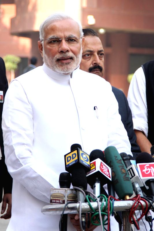 Prime Minister Narendra Modi addresses press ahead of attending the first day of Parliament's winter session in New Delhi, on Nov 24, 2014. - Narendra Modi