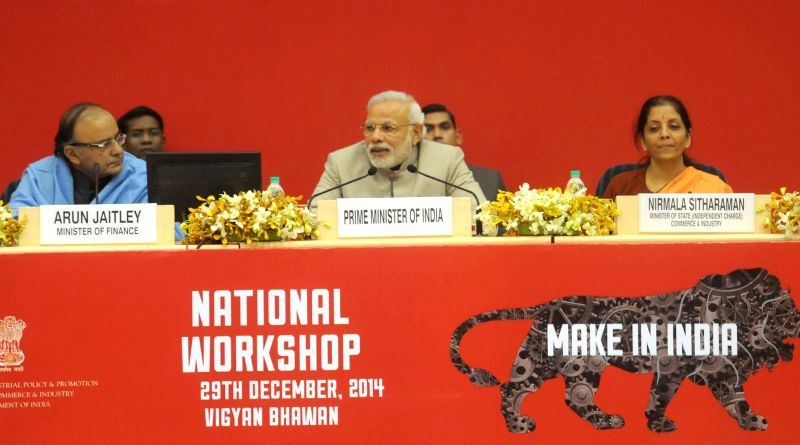 Prime Minister Narendra Modi addresses at the National Workshop on `Make in India`, in New Delhi on Dec 29, 2014. Also seen the Union Minister for Finance, Corporate Affairs, and ... - Narendra Modi and Arun Jaitley