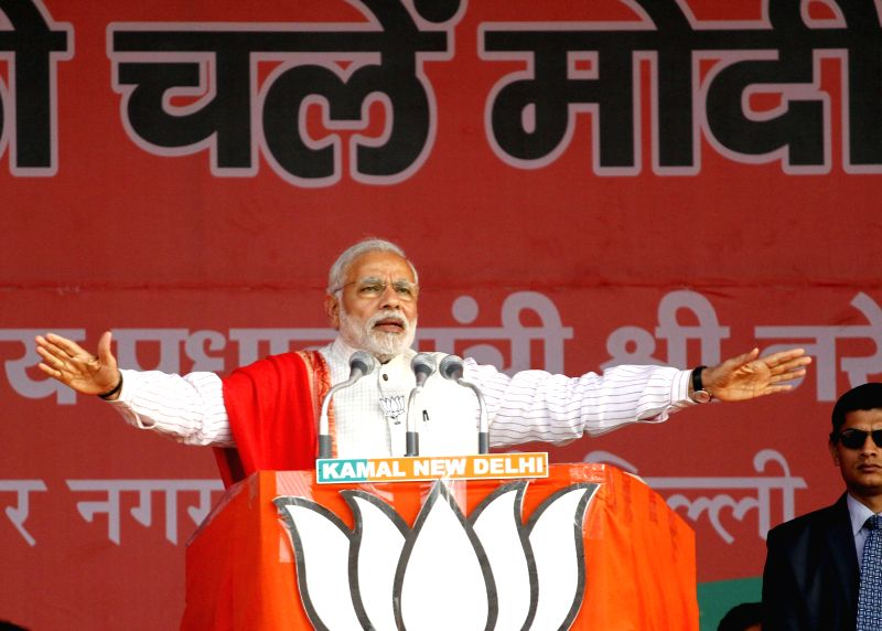 Prime Minister Narendra Modi addresses during a rally for the upcoming Delhi Assembly Election in New Delhi on Feb. 4, 2015. - Narendra Modi