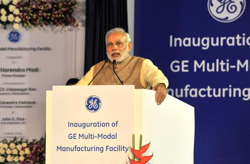 Prime Minister Narendra Modi addresses at the inauguration of the Multimodal Manufacturing Project of GE, at Chakan, in Pune on Feb 14, 2015. - Narendra Modi