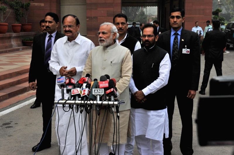 Prime Minister Narendra Modi addresses press ahead of the Budget Session of Parliament in New Delhi, on Feb 23, 2015. Also seen the Union Minister for Urban Development, Housing and Urban ... - Narendra Modi and M. Venkaiah Naidu