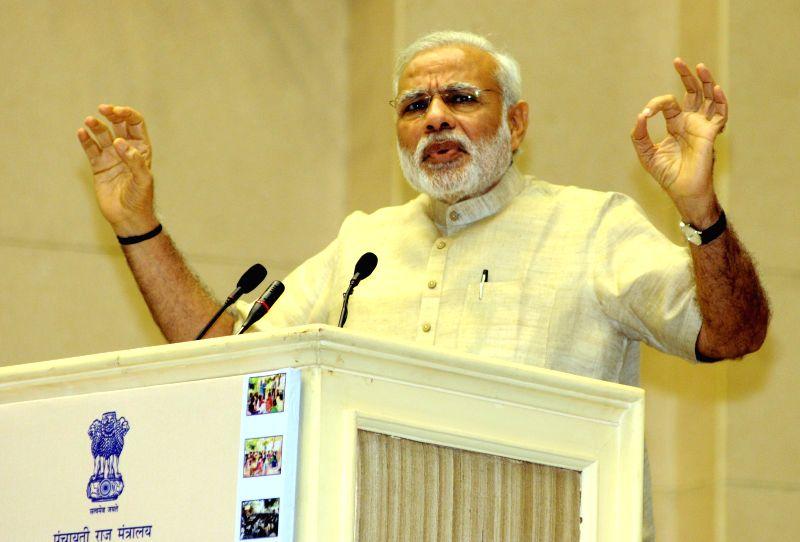 Prime Minister Narendra Modi addresses at the National Panchayati Raj Day function, in New Delhi on April 24, 2015. (Photo : IANS) - Narendra Modi