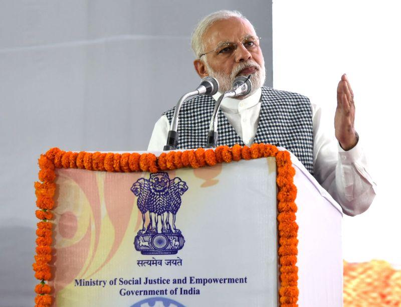 :New Delhi: Prime Minister Narendra Modi addresses at the inauguration of the Dr. Ambedkar National Memorial at 26 Alipur Road, Delhi on April 13, 2018. (Photo: IANS/PIB).