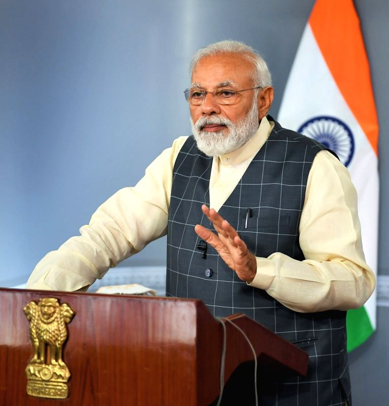 "New Delhi: Prime Minister Narendra Modi addresses the beneficiaries of Pradhan Mantri Bhartiya Janaushadhi Pariyojana (PMBJP) via video-conference, on ""Jan Aushadhi Diwas"", in New Delhi, on March 7, 2019. (Photo: IANS/PIB)"