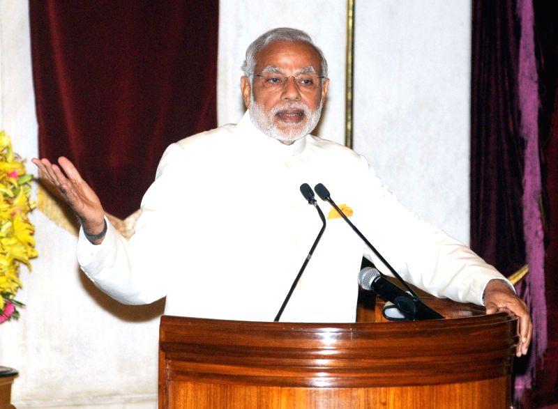 :New Delhi: Prime Minister Narendra Modi addressing the visitors during the launch of IMPRINT India Brochure, at Rashtrapati Bhavan, in New Delhi on November 05, 2015. (Photo: IANS/PIB). - Narendra Modi