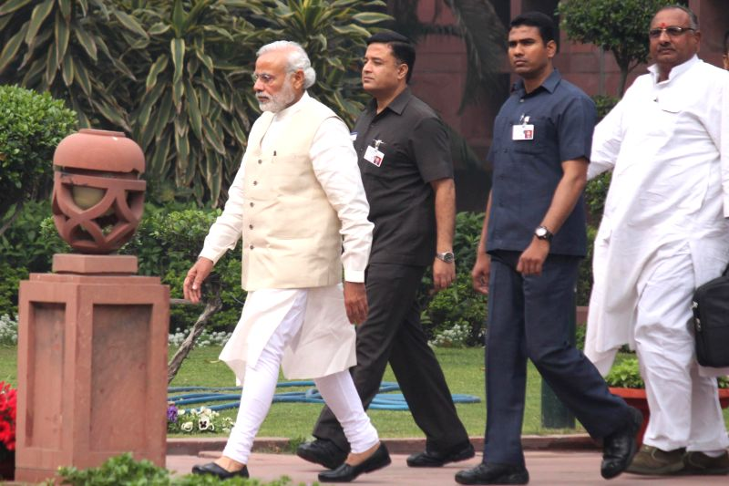 Prime Minister Narendra Modi after a BJP parliamentary party meeting on land acquisition ordinance at the Parliament in New Delhi, on Feb 24, 2015. - Narendra Modi