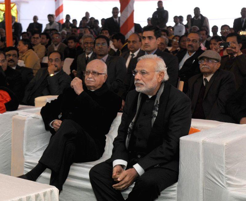 Prime Minister Narendra Modi and BJP veteran and party MP from Gandhinagar L K Advani at a Sankranti Milan programme organised by the Union Minister for Urban Development, Housing and ... - Narendra Modi and M. Venkaiah Naidu