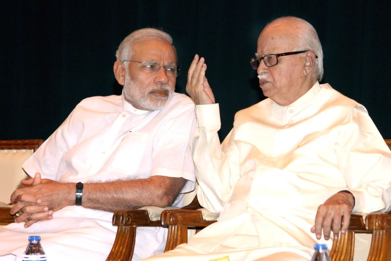 Prime Minister Narendra Modi and BJP leader LK Advani at the BJP parliamentary party meeting at Parliament library on April 21, 2015. - Narendra Modi
