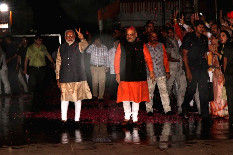 New Delhi: Prime Minister Narendra Modi and BJP chief Amit Shah arrive at the party's headquarters after the BJP-led NDA swept the 2019 Lok Sabha battle and is set to retain power for another five years, in New Delhi on May 23, 2019. (Photo: Amlan Pa