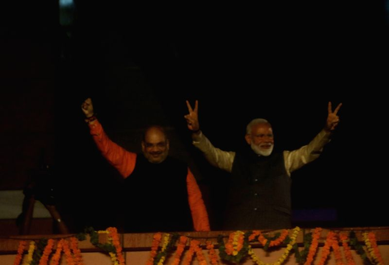 New Delhi:  Prime Minister Narendra Modi and BJP chief Amit Shah during celebrations at the party's headquarters after the BJP-led NDA swept the 2019 Lok Sabha battle and is set to retain power for another five years, in New Delhi on May 23, 2019. (P