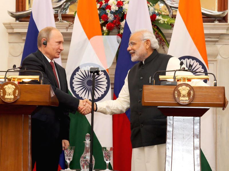 Prime Minister Narendra Modi and the President of the Russian Federation, Vladimir Putin at a joint press conference, in New Delhi on Dec 11, 2014. - Narendra Modi