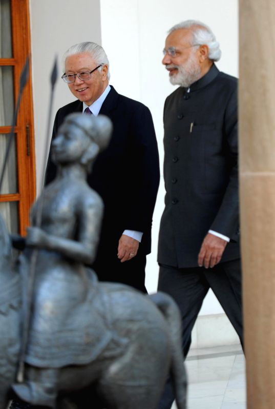 Prime Minister Narendra Modi and the President of the Republic of Singapore Dr. Tony Tan Keng Yam during a meeting at the Hyderabad House, in New Delhi on Feb 9, 2015. - Narendra Modi