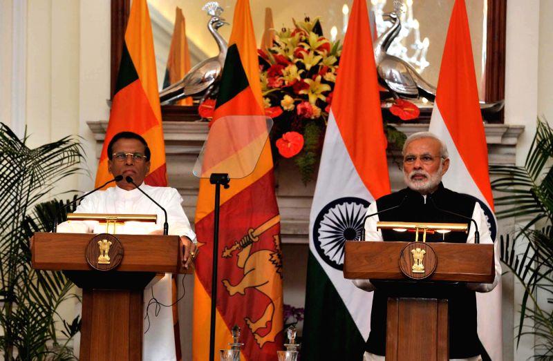 Prime Minister Narendra Modi and the President of the Democratic Socialist Republic of Sri Lanka, Maithripala Sirisena address during a Joint press interaction, in New Delhi on Feb 16, ... - Narendra Modi