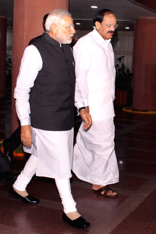 Prime Minister Narendra Modi and the Union Minister for Urban Development, Housing and Urban Poverty Alleviation and Parliamentary Affairs M Venkaiah Naidu arrive at the Parliament to ... - Narendra Modi and Venkaiah Naidu