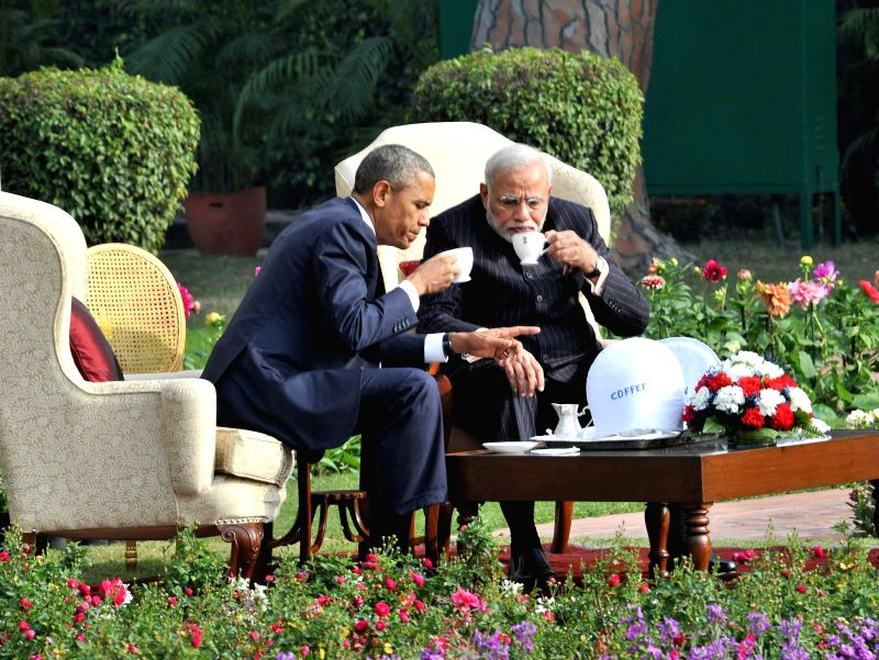 Prime Minister Narendra Modi and US President Barack Obama during a meeting over a cup of tea at the Hyderabad House garden in New Delhi, on Jan 25, 2015. - Narendra Modi