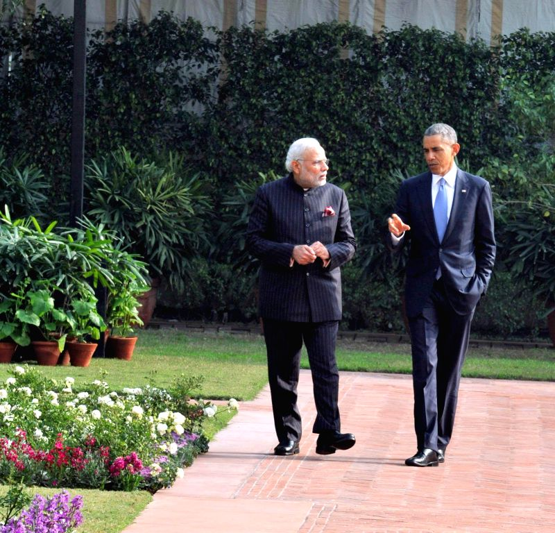 Prime Minister Narendra Modi and US President Barack Obama take a stroll in the garden of Hyderabad House after a working lunch in New Delhi, on Jan 25, 2015. - Narendra Modi