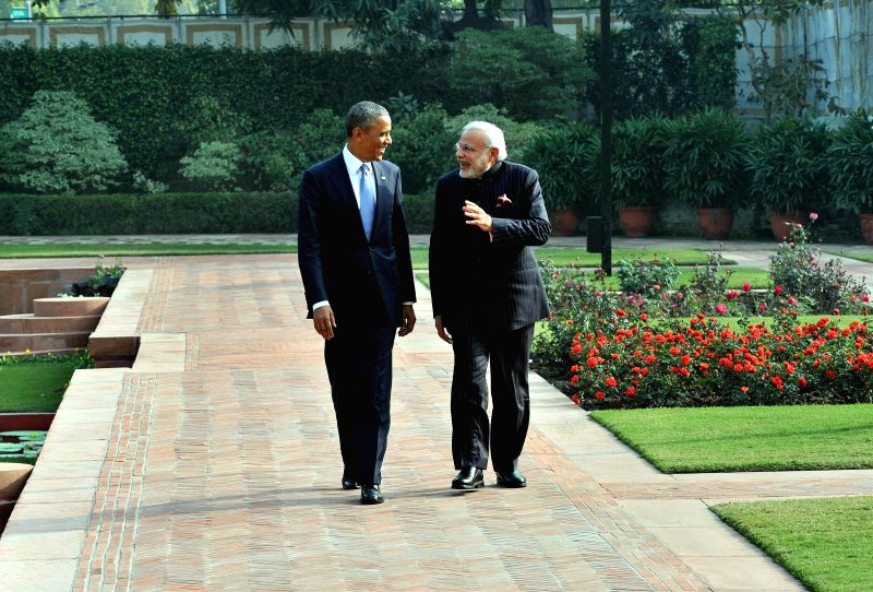 Prime Minister Narendra Modi and US President Barack Obama during a stroll after lunch at Hyderabad House in New Delhi on Jan. 25, 2015. ( Photo : IANS) - Narendra Modi