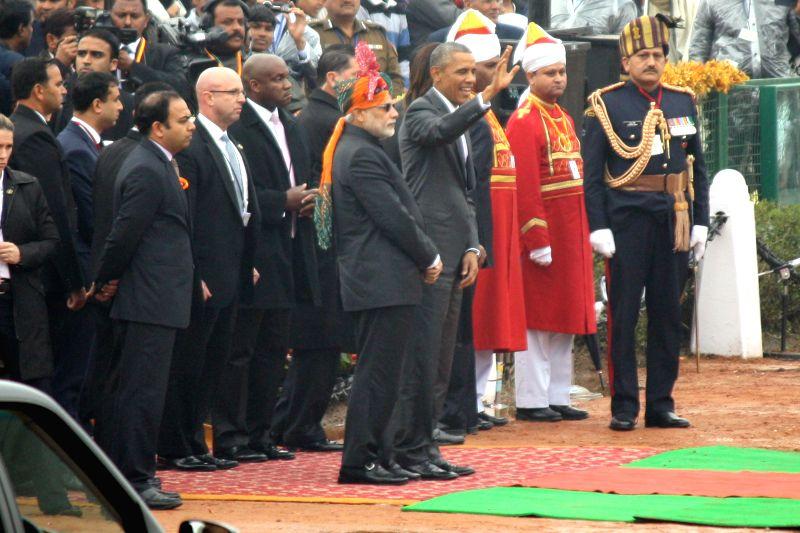 Prime Minister Narendra Modi and US President Barack Obama wait for President Pranab Mukherjee's arrival  during  Republic Day celebrations at Rajpath in New Delhi, on Jan 26, 2015. - Narendra Modi and Pranab Mukherjee