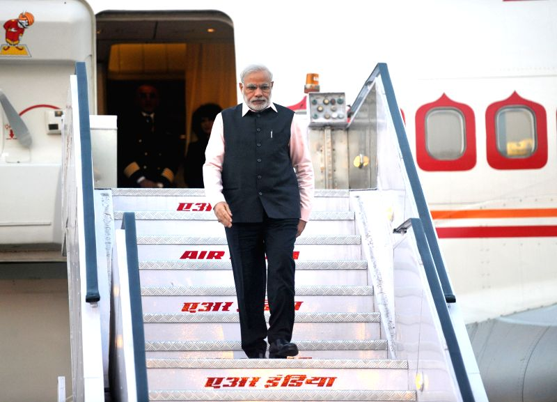 Prime Minister, Narendra Modi arrives after his three nation visit to France, Germany and Canada, in New Delhi on April 18, 2015. - Narendra Modi