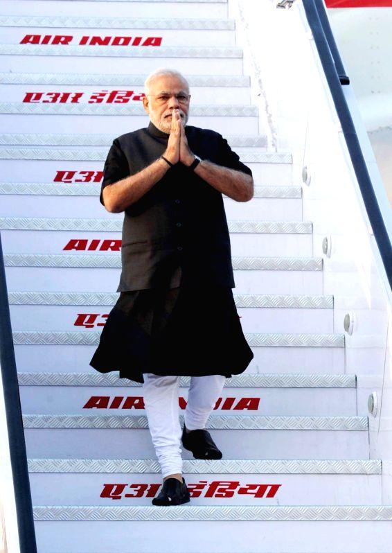 Prime Minister Narendra Modi arrives at Delhi, after his 10 day visit to Myanmar, Australia and Fiji on Nov 20, 2014. - Narendra Modi