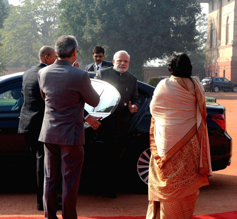 Prime Minister Narendra Modi arrives at the Rashtrapati Bhavan to welcome the President of the Republic of Singapore Dr. Tony Tan Keng Yam in New Delhi on Feb 9, 2015. - Narendra Modi