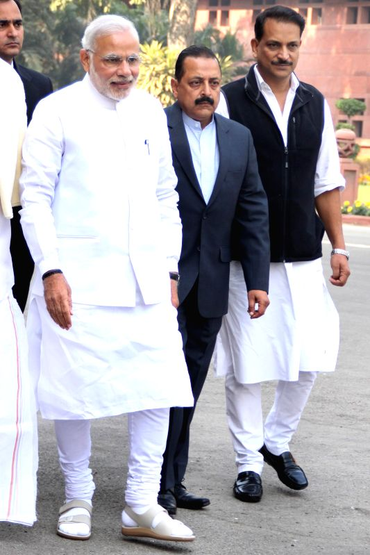 Prime Minister Narendra Modi arrives to attend the first day of Parliament's winter session in New Delhi, on Nov 24, 2014. Also seen Union MoS for Prime Minister's Office Dr. Jitendra ... - Narendra Modi and Jitendra Singh
