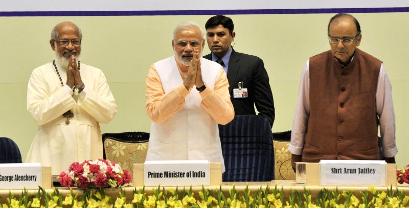 Prime Minister Narendra Modi at programme organised to celebrate the Elevation to Sainthood of Kuriakose Elias Chavara and Mother Euphrasia, in New Delhi on Feb 17, 2015. Also seen Union .. - Narendra Modi and Arun Jaitley