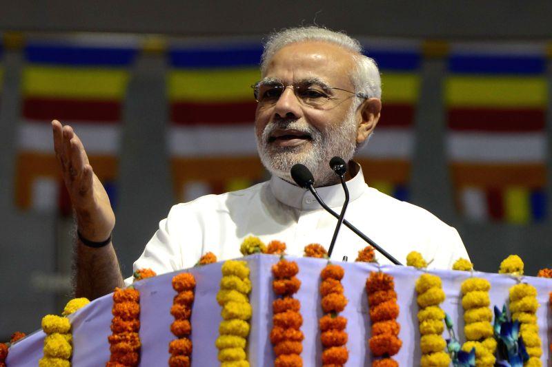 New Delhi : Prime Minister Narendra Modi at International Buddha Poornima Diwas Celebration 2015 in New Delhi on May 4, 2015. ( Photo : IANS)