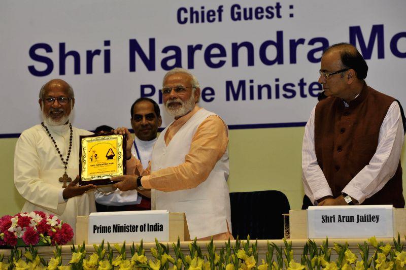 Prime Minister Narendra Modi at a programme organised to celebrate the Elevation to Sainthood of Kuriakose Elias Chavara and Mother Euphrasia, in New Delhi on Feb 17, 2015. Also seen Union - Narendra Modi and Arun Jaitley